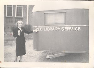 Miss Josephine Du Puy in front of Library trailer